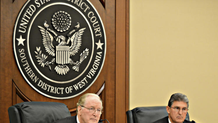 US Sen. Jay Rockefeller D-WV and US Sen. Joe Manchin, D-WV, right, listen to  testimony during a hearing on pipeline safety in Charleston, W.Va., Monday Jan.28, 2013.  Before the hearing, Rockefeller criticized the U.S. Office of Management of Budget for slowing down potential safety rules meant to respond to the Sissonville explosion and similar accidents. (AP Photo/Charleston Daily Mail, Tom Hindman)