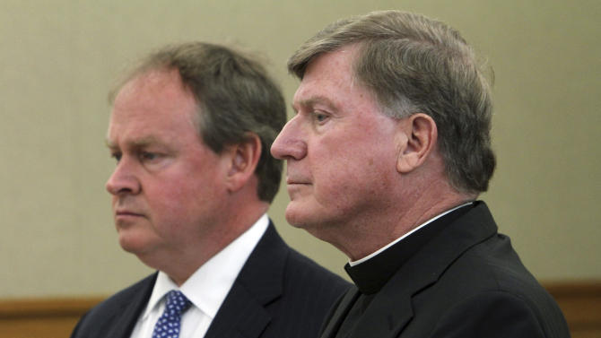 Bishop Robert McManus, Roman Catholic bishop of the  Worcester, Mass., diocese stands in court with his attorney William Murphy, left, in South Kingstown, R.I., Tuesday, May 7, 2013, as he is arraigned on charges of drunken driving and leaving the scene of an accident Saturday in Rhode Island.  (AP Photo/Providence Journal, Frieda Squires, Pool)