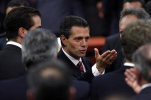 Enrique Pena Nieto gestures after the presentation of the fiscal reform at Los Pinos presidential residence in Mexico City