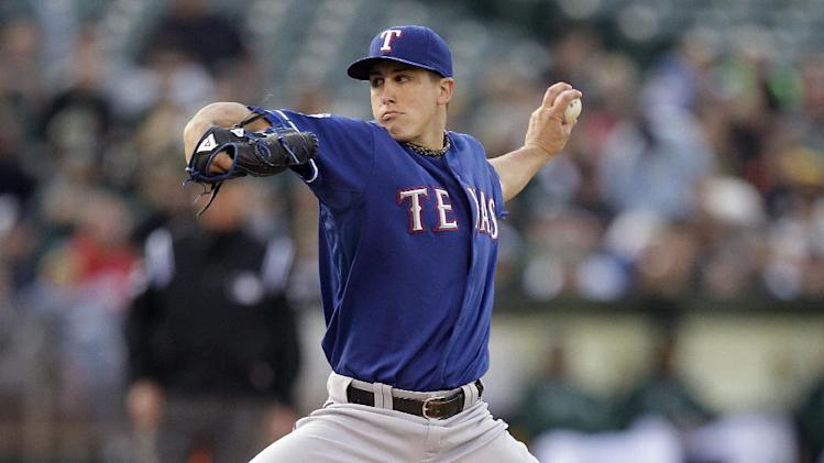 Texas Rangers' Derek Holland works against the Oakland Athletics in the first inning of a baseball game, Tuesday, June 5, 2012, in Oakland, Calif. (AP Photo/Ben Margot)