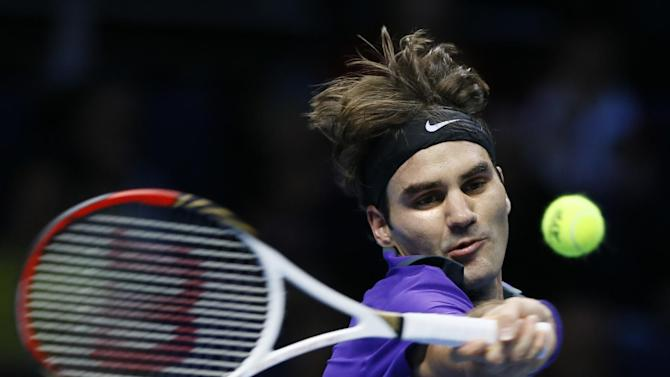 Roger Federer of Switzerland plays a return to David Ferrer of Spain during their singles tennis match at the ATP World Tour Finals in London, Thursday, Nov. 8, 2012. (AP Photo/Kirsty Wigglesworth)