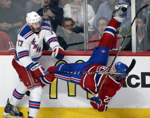Montreal's Dale Weise returned to play after suffering what was later revealed to be a concussion on a hit by the Rangers' John Moore in Game 6 of Eas...