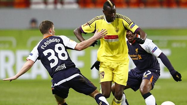 Anzhi Makhachkala's Lacina Traore (C) fights for the ball with Liverpool's Jon Flanagan (L) and Andre Wisdom during their Europa League Group A match