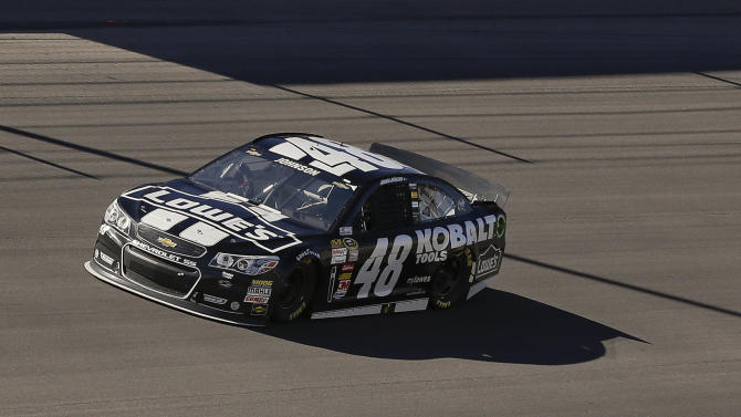 Jimmie Johnson leads the pack early during the NASCAR Sprint Cup Series auto race, Sunday, March 10, 2013 in Las Vegas. (AP Photo/Julie Jacobson)