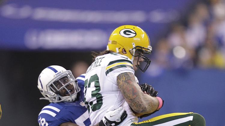 Green Bay Packers tight end Tom Crabtree is tackled by Indianapolis Colts linebacker Moise Fokou during the first half of an NFL football game in Indianapolis, Sunday, Oct. 7, 2012. (AP Photo/Michael Conroy)