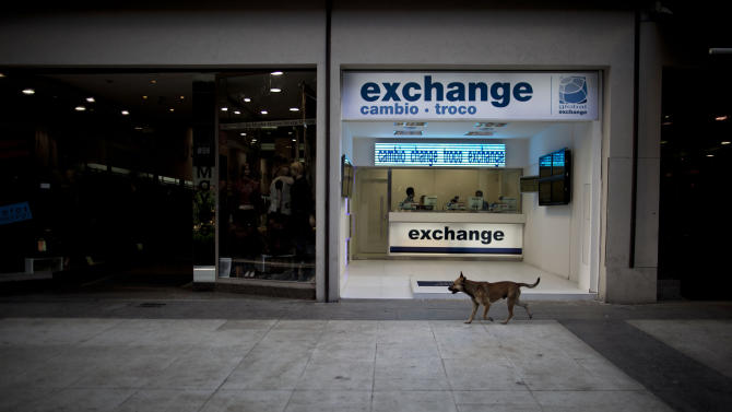 In this June 5, 2013 photo photo, a money exchange shop sits empty along Florida street in Buenos Aires, Argentina. Visitors who turn to the street rather than the banks to swap their dollars are getting a bonanza of extra Argentine pesos and can shop much more cheaply than back at home. (AP Photo/Natacha Pisarenko)