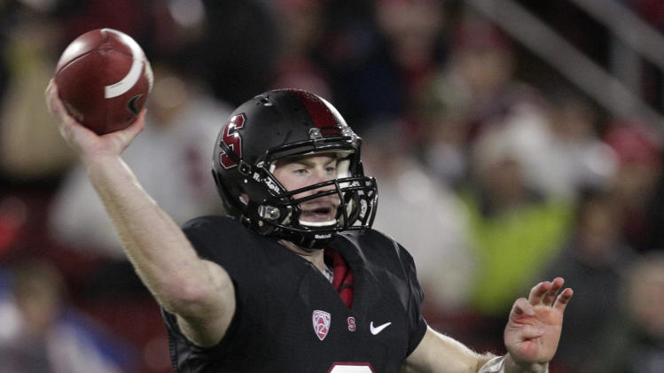 Stanford quarterback Kevin Hogan throws against UCLA during the first half of the Pac-12 championship NCAA college football game in Stanford, Calif., Friday, Nov. 30, 2012. (AP Photo/Tony Avelar)