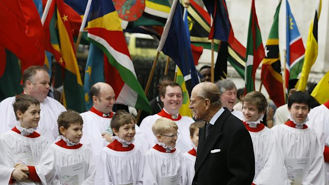 Britain's Prince Philip speaks to choir boys after attending the Commonwealth Day Observance service at Westminster Abbey in London, Monday, March 11, 2013. Britain's Queen Elizabeth II was due to attend but cancelled Monday as she continues to recover from her recent illness. Commonwealth Day Observance has a different theme every year, with the 2013 focus on 'Opportunity through Enterprise.'  Queen Elizabeth II is the head of the Commonwealth, a voluntary association of 54 countries. (AP Photo/Kirsty Wigglesworth)