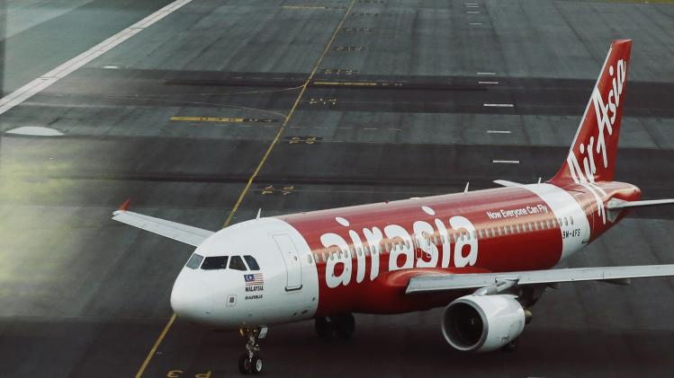An AirAsia plane is seen on the runway at Kuala Lumpur International Airport