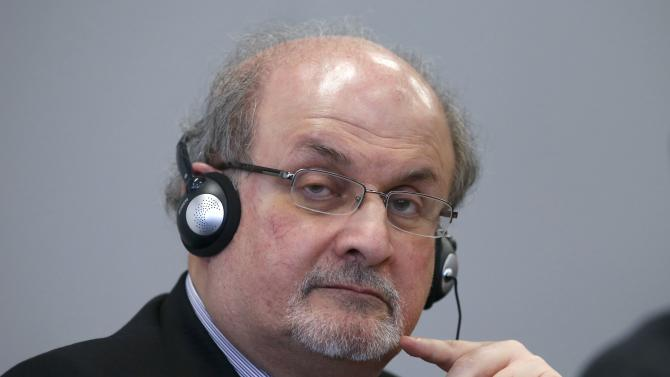 Author Rushdie listens during the opening news conference of the Frankfurt book fair