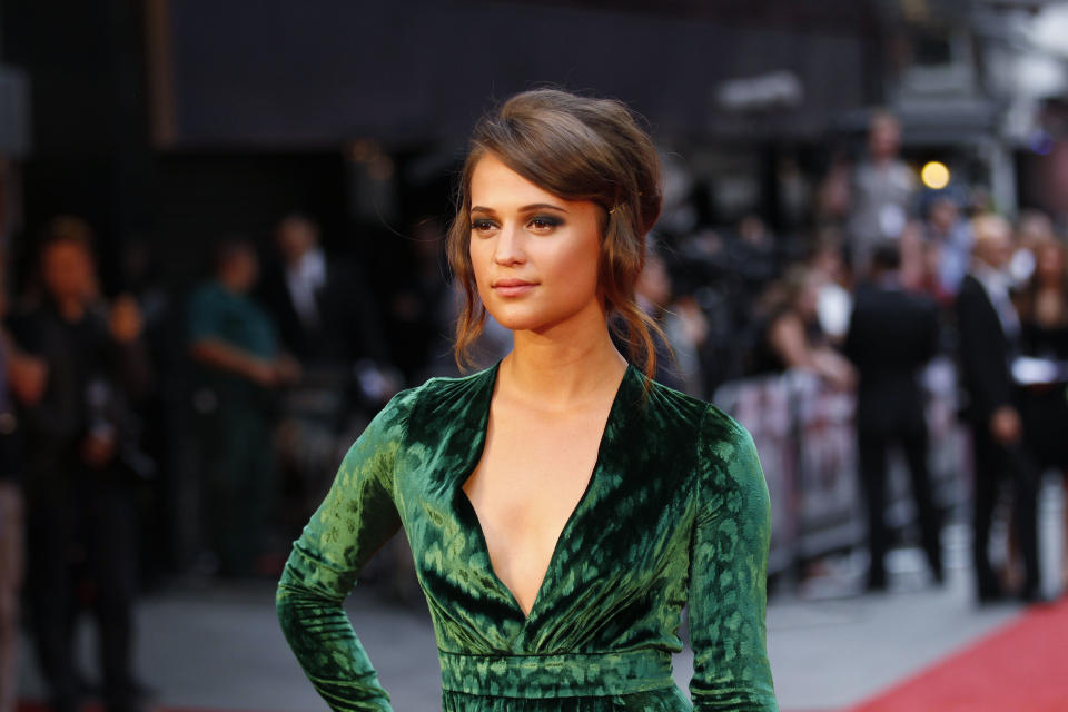 Cast member Swedish actress Alicia Vikander poses as she arrives for the world premiere of Anna Karenina in London, Tuesday, Sept. 4, 2012. (AP Photo/Sang Tan)