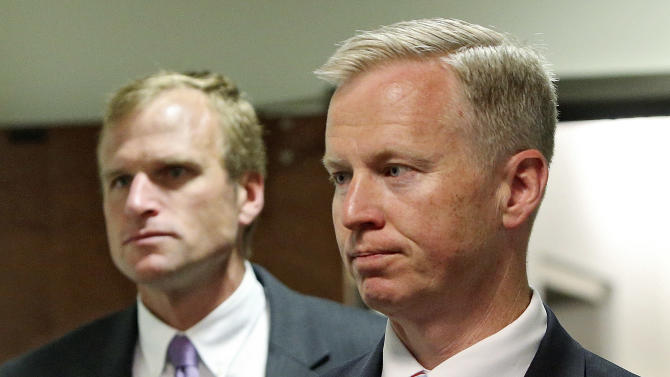 District Attorney George Brauchler, right, and Assistant District Attorney Mark Hurlbert arrive for a hearing in Centennial, Colo., where Aurora theater shooting suspect James Holmes asked a judge to enter a plea of not guilty by reason of insanity, in Centennial, Colo., on Monday, May 13, 2013. (AP Photo/Ed Andrieski)
