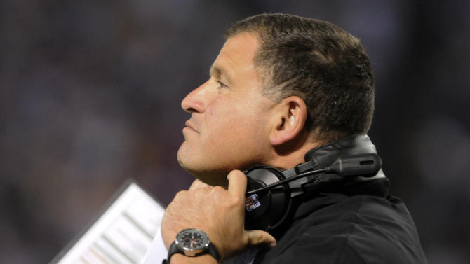 Tampa Bay Buccaneers head coach Greg Schiano watches during the first half of an NFL football game against the Minnesota Vikings, Thursday, Oct. 25, 2012, in Minneapolis. (AP Photo/Jim Mone)