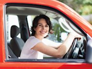 woman driving red car