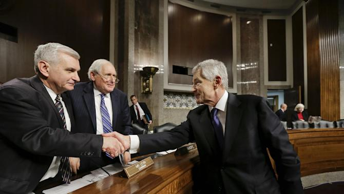 Chuck Hagel, right, President Obama's nominee to become secretary of defense, shakes hands with Sen. Jack Reed, D-R.I., far left, and Senate Armed Services Committee Chairman Carl Levin, D-Mich., second from left, at the end of his confirmation hearing,  on Capitol Hill in Washington, Thursday, Jan. 31, 2013.  (AP Photo/J. Scott Applewhite)