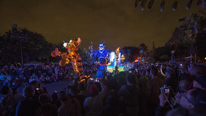 "People watch the ""Paint the Night - All-New Electrical Parade"" during Disneyland's Diamond Celebration in Anaheim"