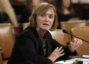 """Marilyn Tavenner, administrator of the Centers for Medicare & Medicaid Services, testifies before a House Ways and Means Committee hearing on """"Affordable Care Act Implementation on Capitol Hill in Washington"""