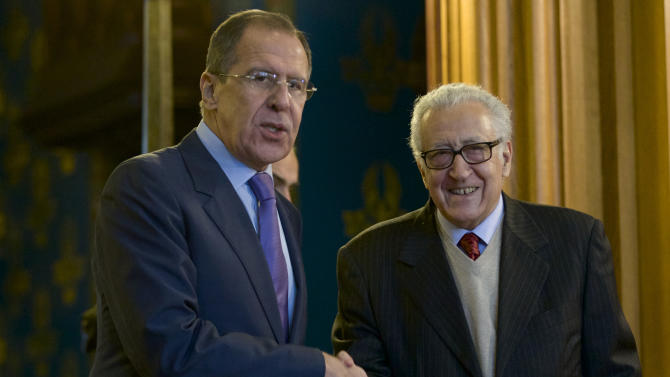 Russian Foreign Minister Sergey Lavrov, left, and U.N. envoy for Syria Lakhdar Brahimi shake hands during their meeting in Moscow, Russia, on Saturday, Dec. 29, 2012. (AP Photo/Ivan Sekretarev)