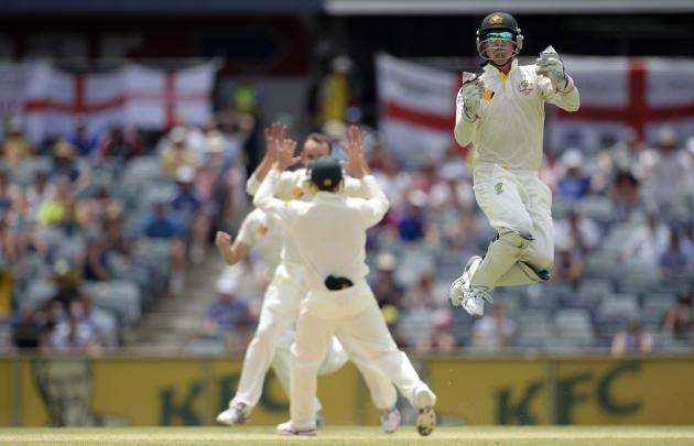 Australia's Haddin leaps as he celebrates the dismissal of England's Stokes during the third Ashes test cricket match in Perth