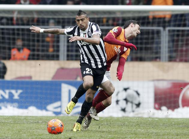 Vidal of Juventus challenges Yilmaz of Galatasaray during their Champions League soccer match in Istanbul
