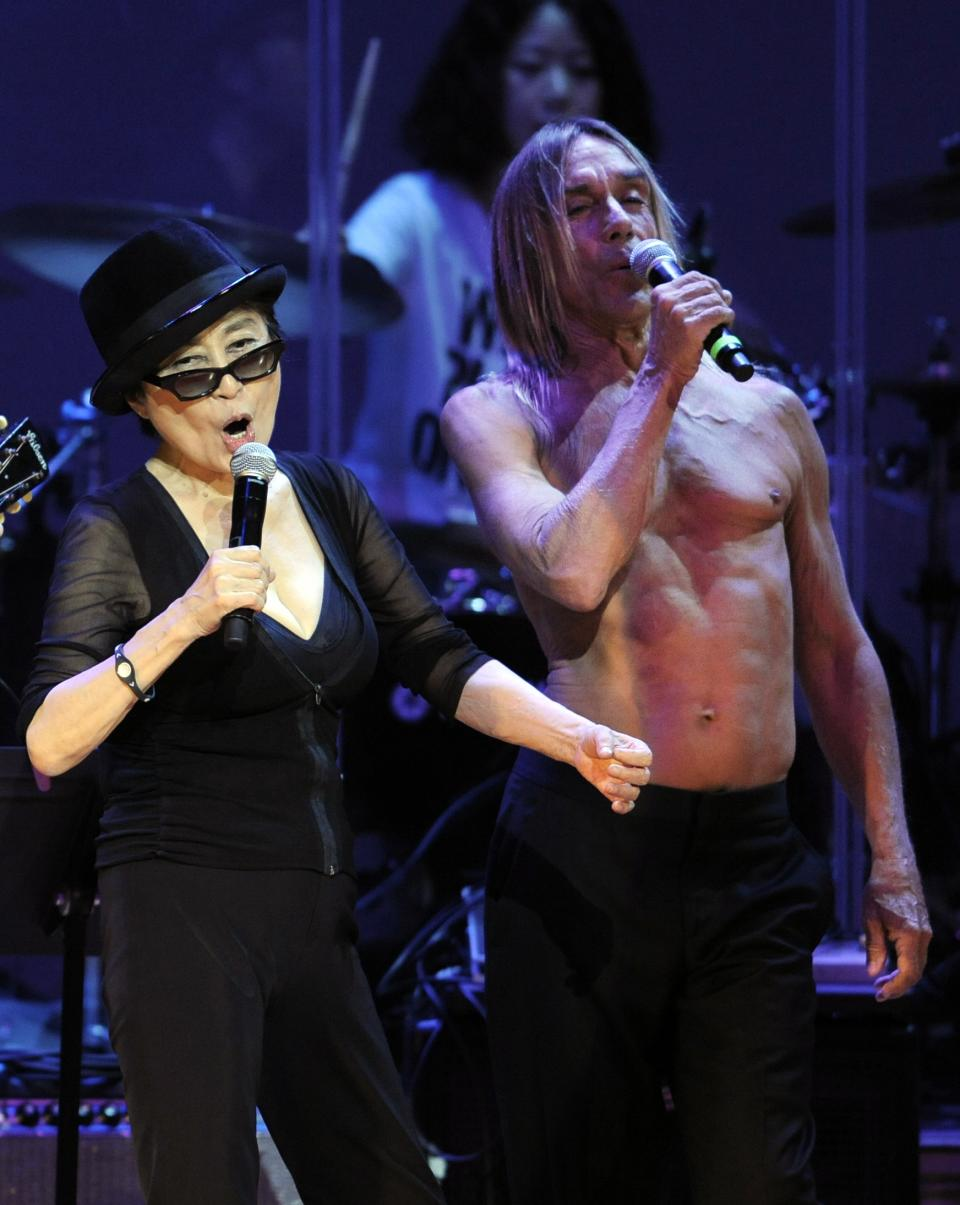 "Yoko Ono, left, performs alongside special guest Iggy Pop during the ""Yoko Ono: We Are Plastic Ono Band"" concert at the Orpheum Theater in Los Angeles, Friday, Oct. 1, 2010. (AP Photo/Chris Pizzello)"