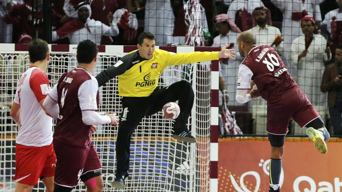 Hassab Alla of Qatar shoots against goalkeeper Szmal of Poland during their semi-final match of the 24th Men's Handball World Championship in Doha