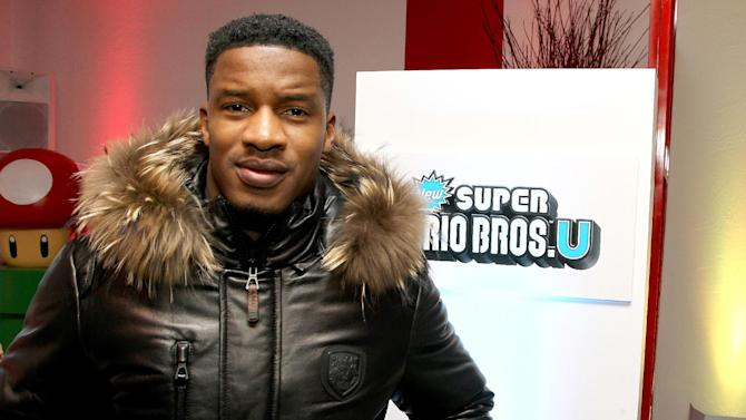 Actor Nate Parker warms up and checks out Wii U at the Nintendo Lounge while playing TKTKTK during a break from the Sundance Film Festival on Saturday, January 20, 2013 in Park City, UT. (Photo by Donald Traill/Invision for Nintendo/AP Images)