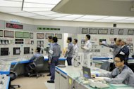 Kansai Electric Power Co (KEPCO) engineers reactivate its nuclear reactor at the company's Oi nuclear power plant at Oi town in Fukui, on July 1. The reactor began full operations on Monday, the first restart since the country shut down its atomic stations in the wake of last year's crisis at the Fukushima Daiichi plant
