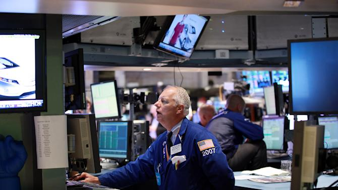 Specialist Thomas A. Bishop works the trading floor of the New York Stock Exchange Thursday Sept. 6, 2012. Stocks hit four-year highs Thursday on news of a long-anticipated plan to support struggling countries in the European Union. (AP Photo/David Karp)
