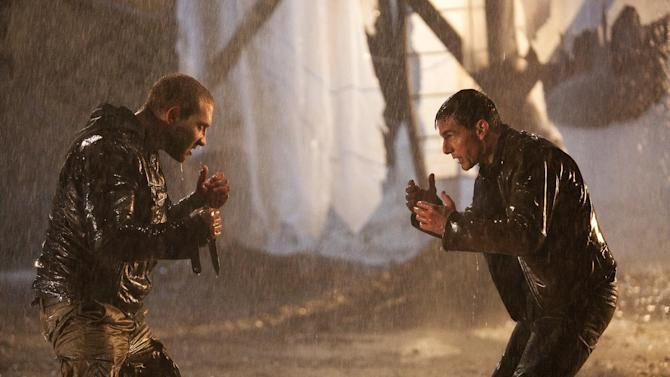 """This undated publicity photo released by Paramount Pictures shows Tom Cruise, right, as Reacher and Jai Courtney as Charlie in the film, """"Jack Reacher."""" (AP Photo/Paramount Pictures, Karen Ballard)"""