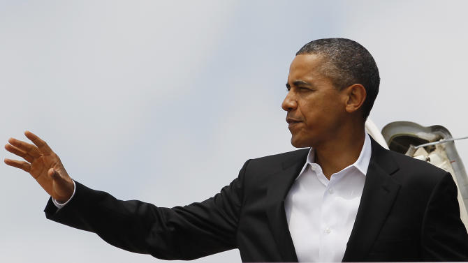 President Barack Obama moves to wave as he boards Air Force One, Saturday, Aug. 11, 2012, in Andrews Air Force Base, Md., en route to Chicago. (AP Photo/Carolyn Kaster)