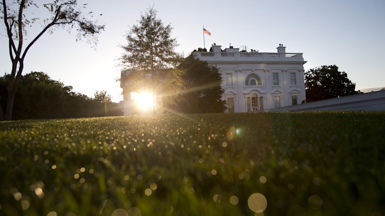 The sun rises behind the White House in Washington, Sunday, Sept. 29, 2013. Locked in a deepening struggle with President Barack Obama, the Republican-controlled House approved legislation early Sunday imposing a one-year delay in key parts of the nation's health care law and repealing a tax on medical devices as the price for avoiding a partial government shutdown in a few days' time. (AP Photo/Carolyn Kaster)