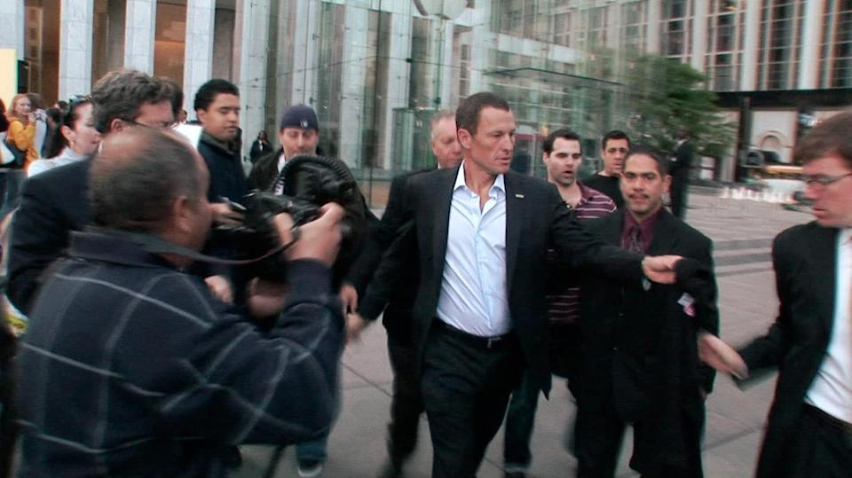 "This photo released by courtesy of Sony Pictures Classics shows Lance Armstrong, center, in the documentary film, ""The Armstrong Lie."" (AP Photo/Courtesy Sony Pictures Classics, Maryse Alberti)"