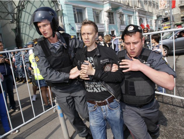 Police detain protesters in downtown Moscow shortly before Vladimir Putin's inauguration Monday, May 7, 2012. Putin's inauguration on Monday comes a day after an opposition protest drew more than 20,0