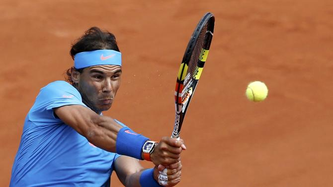 Rafael Nadal of Spain plays a shot to Quentin Halys of France during their men's singles match at the French Open tennis tournament at the Roland Garros stadium in Paris