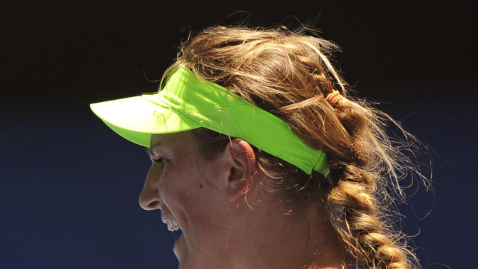 Victoria Azarenka of Belarus reacts after winning a point against Agnieszka Radwanska of Poland during their quarterfinal at the Australian Open tennis championship, in Melbourne, Australia, Tuesday, Jan. 24, 2012.   (AP Photo/Andrew Brownbill)