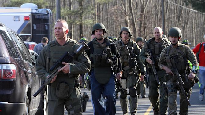 Heavily armed Connecticut State troopers are on the scene at Sandy Hook Elementary School in Newtown, Conn. where authorities say a gunman opened fire, leaving 27 people dead, including 20 children, Friday, Dec. 14, 2012. (AP Photo/The Journal News, Frank Becerra Jr.) MANDATORY CREDIT, NYC OUT, NO SALES, TV OUT, NEWSDAY OUT; MAGS OUT