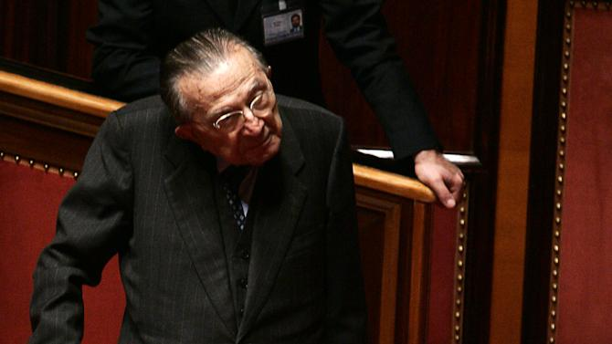 FILE - In this file photo taken on April 29 2006, Italian former Premier Giulio Andreotti walks at the Senate in Rome.  Italian state television says Giulio Andreotti, Italy's former seven-time premier, has died at age 94. At his prime, Andreotti was one of Italy's most powerful men: he helped draft the country's constitution after World War II, sat in parliament for 60 years and served as premier seven times. Andreotti was hospitalized last year with heart problems stemming from a respiratory infection. (AP Photo/Plinio Lepri, file)