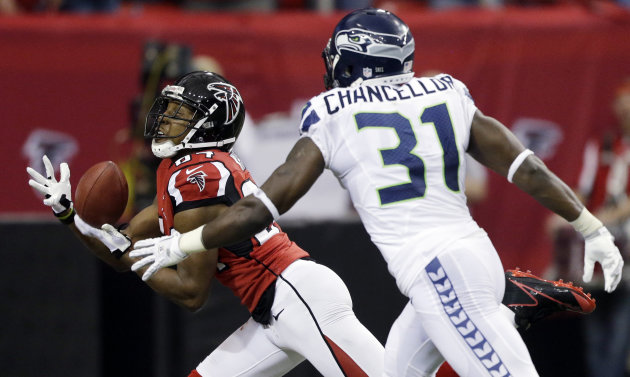 Atlanta Falcons wide receiver Roddy White (84) makes a touch-down catch against Seattle Seahawks strong safety Kam Chancellor (31) during the first half of an NFC divisional playoff NFL football game