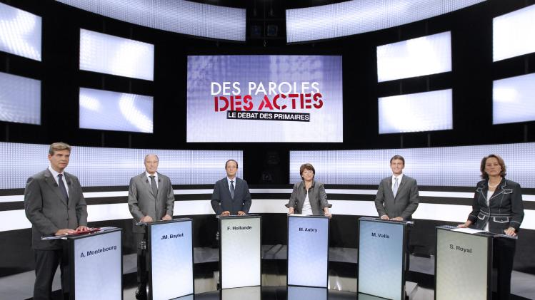 French candidates for the 2011 Socialist party primary elections before France's 2012 presidential election, from the left, Arnaud Montebourg, Jean-Michel Baylet, Francois Hollande, Martine Aubry, Manuel Valls and Segolene Royal take part in a televised debate on a French TV channel, Thursday Sept. 15, 2011. Socialist leaders will hold three debates and are seeking the party's nomination next month for presidential elections in May 2012. Writing reads: Talks and acts, the primary debate. (AP Photo/Patrick Kovarik, Pool)
