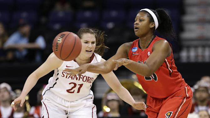 Georgia's Shacobia Barbee, right, passes as Stanford's Sara James defends in the first half of a regional semifinal game in the NCAA women's college basketball tournament Saturday, March 30, 2013, in Spokane, Wash. (AP Photo/Elaine Thompson)