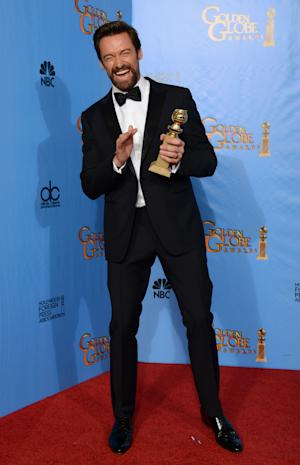 "Actor Hugh Jackman poses with the award for best performance by an actor in a motion picture - comedy or musical for ""Les Miserables"" backstage at the 70th Annual Golden Globe Awards at the Beverly Hilton Hotel on Sunday Jan. 13, 2013, in Beverly Hills, Calif. (Photo by Jordan Strauss/Invision/AP)"