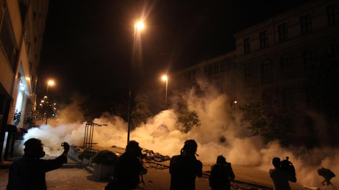 Media cover the clashes between police and protesters for fifth day in Istanbul, early Wednesday, June 5, 2013. Turkey's deputy prime minister offered an apology Tuesday for the government's violent crackdown on an environmental protest, a calculated bid to ease days of anti-government rallies in the country's major cities. (AP Photo/Thanassis Stavrakis)