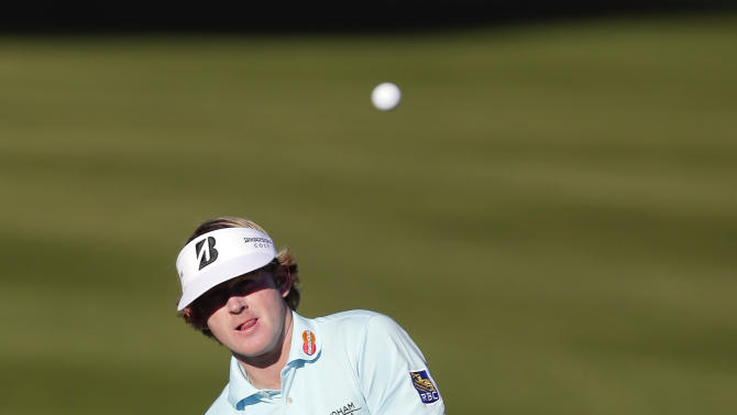 Brandt Snedeker chips to the second hole during the first round of the Humana Challenge golf tournament at the La Quinta Country Club in La Quinta, Calif., Thursday, Jan. 17, 2013. (AP Photo/Chris Carlson)