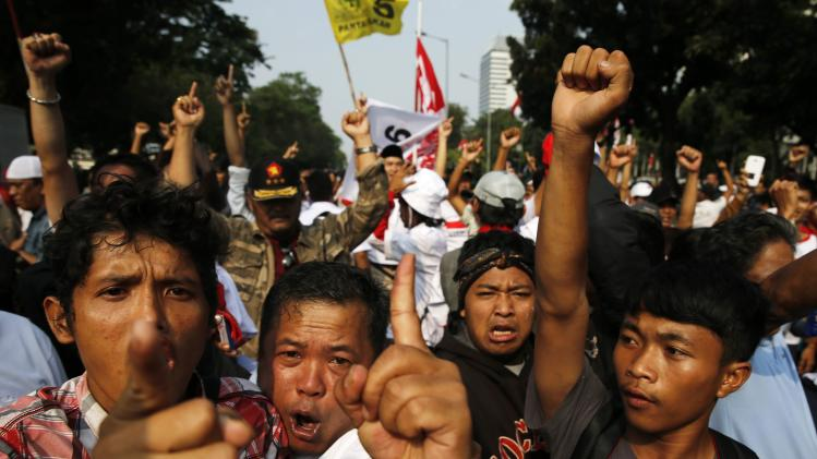Supporters of presidential candidate Prabowo Subianto shout slogans during a protest near the Constitutional Court in Jakarta