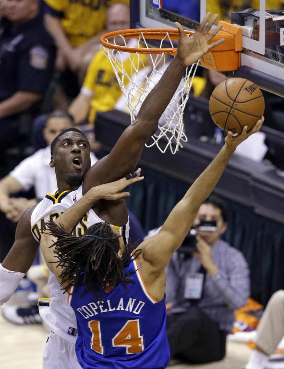 Indiana Pacers center Roy Hibbert, left, blocks the shot of New York Knicks forward Chris Copeland during the second quarter of Game 6 of the Eastern Conference semifinal NBA basketball playoff series in Indianapolis, Saturday, May 18, 2013. (AP Photo/Michael Conroy)