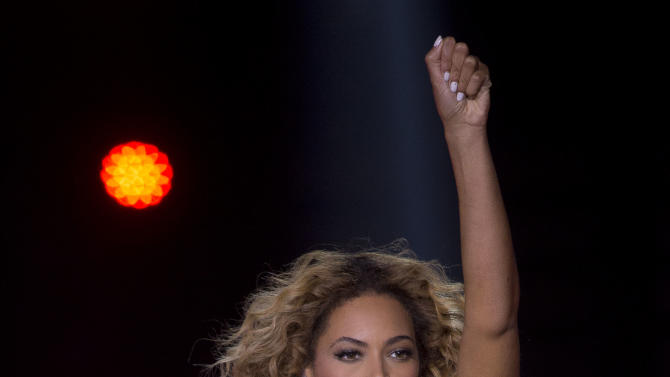 IMAGE DISTRIBUTED FOR PARKWOOD ENTERTAINMENT - Singer Beyonce performs on stage during her Mrs. Carter Show World Tour 2013, on Friday, April 26, 2013, at the LG Arena in Birmingham, UK. (Photo by Joel Ryan/Invision for Parkwood Entertainment/AP)