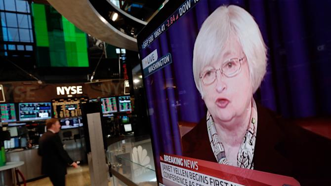 A television screen on the floor of the New York Stock Exchange shows Federal Reserve Chair Janet Yellen's first news conference, in Washington D.C., Wednesday, March 19, 2014. The Federal Reserve is seeking to clarify when it might start to raise short-term interest rates from record lows. The Fed also says it will cut its monthly long-term bond purchases by another $10 billion to $55 billion because it thinks the economy is strong enough to support further improvements in the job market. (AP Photo/Richard Drew)