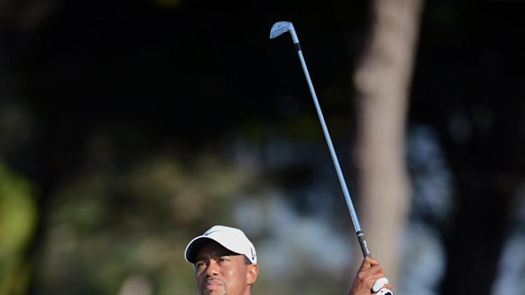 USA's Tiger Woods watches the flight of his ball  during his World Golf Final Group 1 match against Rory McIlroy of Northern Ireland  in Belek, Antalya, Turkey, Thursday, Oct. 11, 2012. (AP Photo)
