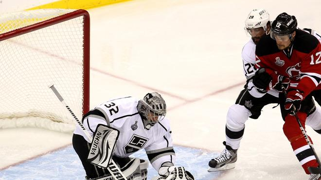 Jonathan Quick #32 Of The Los Angeles Kings Covers The Puck As Jarret Stoll #28 Of The Los Angeles Kings And Alexei  Getty Images
